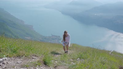 Young Girl Climbs the Mountain in the Alps