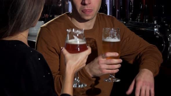 Thumbnail for Lovely Couple Clinking Their Beer Glasses, Celebrating Anniversary at Restaurant