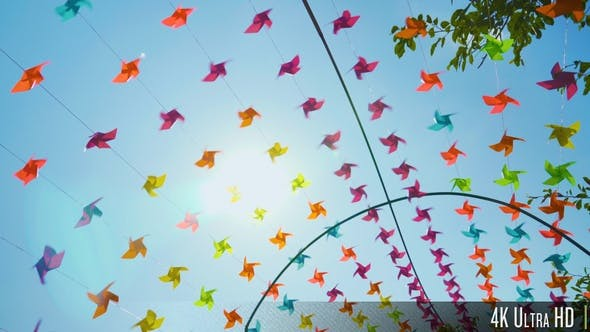 Thumbnail for 4K Colorful Pinwheels Spin on a Sunny Summer Day