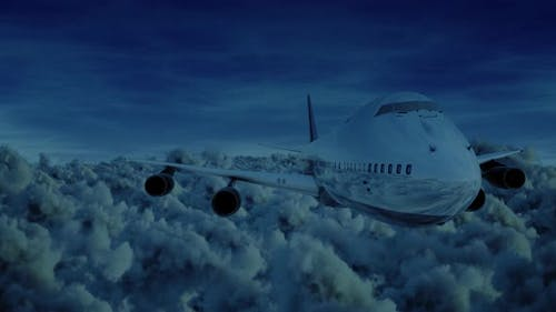 Airplane Jumbo Jet Front View Fyling Over Storm Clouds At Night Moonlight Seamless Loop