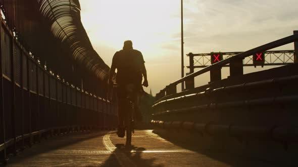 Riding a Bike on A Bridge