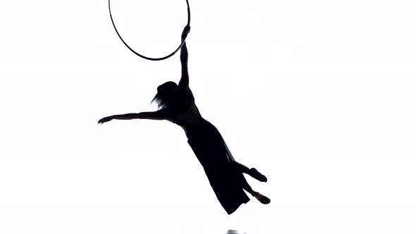 Thumbnail for Aerial Acrobat Woman on Circus Stage. Silhouette on a White Background.