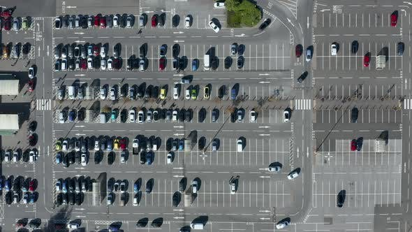 Cover Image for Overhead via of a busy parking lot