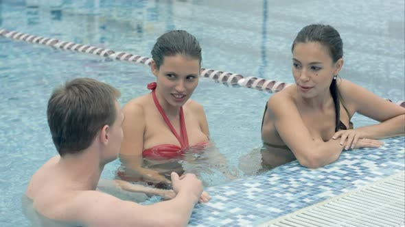Thumbnail for Two Women Talking To a Young Man in the Swimming Pool