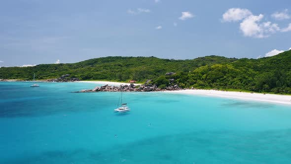 Thumbnail for Aerial View Footage of Luxury Catamaran Yachts Moored Clear Turquoise Blue Ocean Water Near Amazing