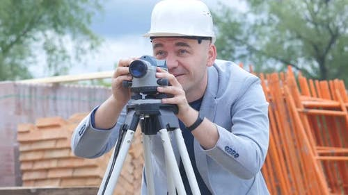 The Engineer Confirms Quality Construction Using Lazer Device