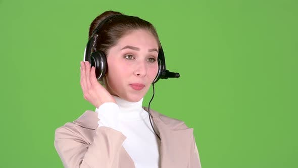 Thumbnail for Support Worker Speaks To Customers on the Headset. Green Screen. Slow Motion