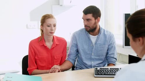 Couple Visiting Doctor at Family Planning Clinic 3