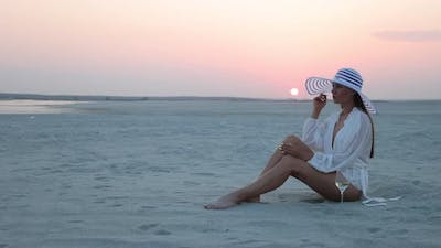 Stylish Woman in Hat Relaxing on Beach