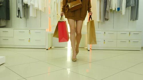 Sale and Consumerism Concept Shopping Girl with Colored Paper Bags Walking in Market Mall