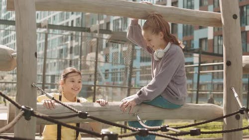 Girls Climbing on Playground at Schoolyard
