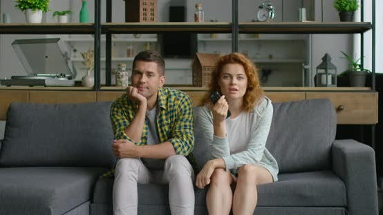 Thumbnail for Young Couple Is Watchning TV in the Living Room
