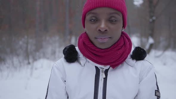 Thumbnail for Portrait of African American Girl Standing in Winter Forest Looking in Camera Close Up