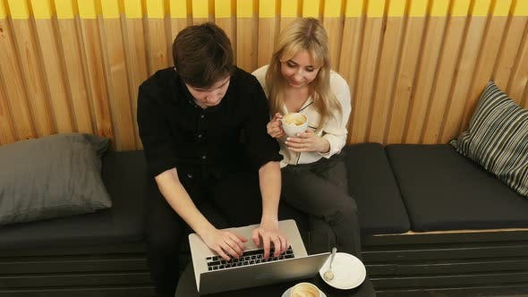 Thumbnail for Hipster Couple Sitting Incafe Drinking Coffee Using Laptop