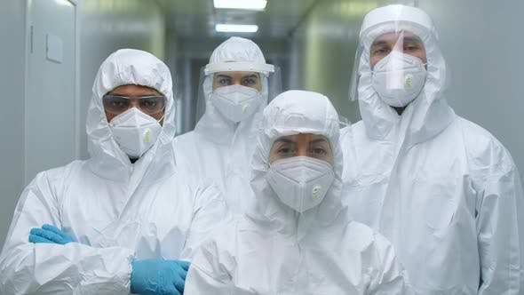 Group of Doctors in Protective Uniforms Posing for Camera