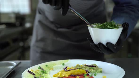 Thumbnail for Chef in Black Gloves Puts Greens on Pancakes with Tongs