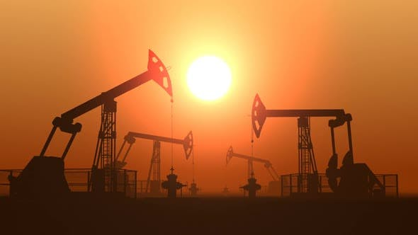 Thumbnail for Working Oil Pump Jacks in a Desert Against Sunset Extracting Crude Oil