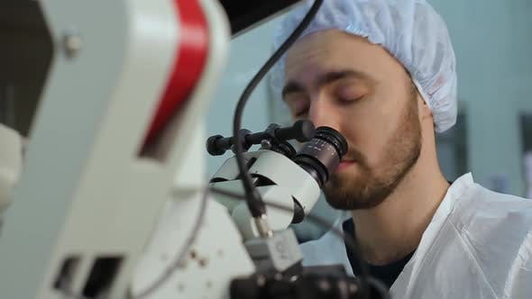Thumbnail for Young Doctor Using Loking at Eyepieces of Microscope Complex System in a Hospital Laboratory