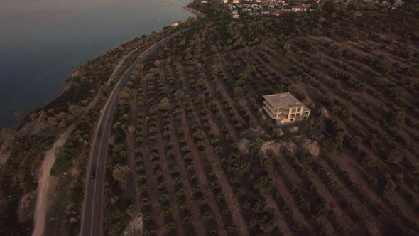 Thumbnail for - Flying Over the Sea and Shoreline with Gardens and Houses. Trikorfo Beach, Greece