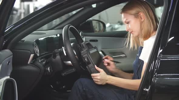 Thumbnail for Mechanic Woman with Automotive Diagnostic Scanner