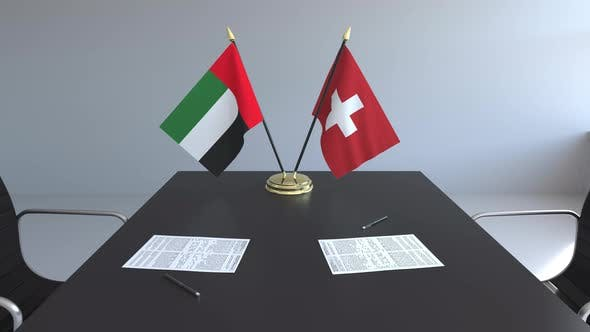 Flags of the United Arab Emirates and Switzerland and Papers