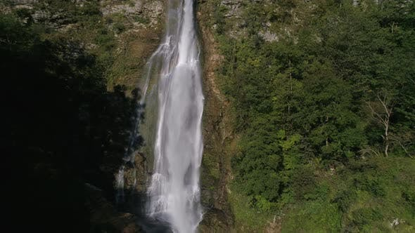 Thumbnail for Slow Motion Rising Above the Waterfall in the Green Forest in Georgia