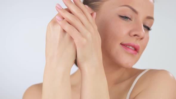 Woman Applying Cosmetic Hand Cream on Hand