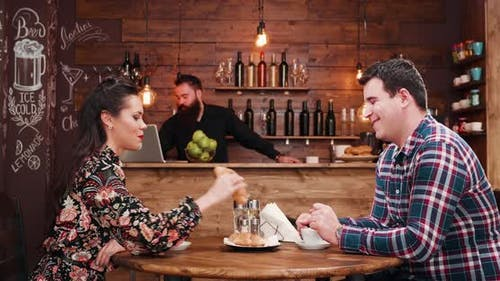 Zoom in Shot of Beautiful Couple Drinking Coffee in Vintage Rustic Coffee Shop Pub Restaurant