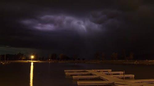 Lightning Time Lapse over pier on lake