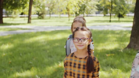 Thumbnail for Cute Diverse Kids Smiling and Posing for Camera One by One in Park
