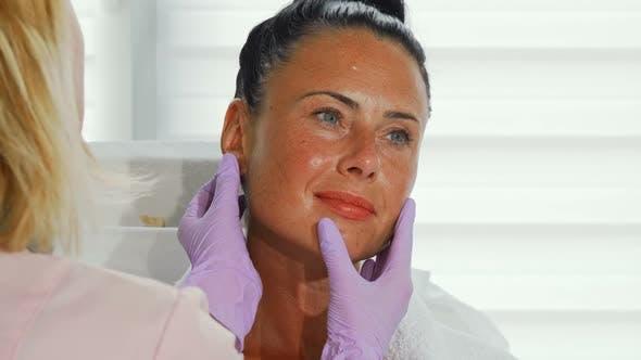 Thumbnail for Gorgeous Mature Woman on Dermatological Skin Examination 1080p
