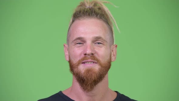 Handsome Bearded Man with Dreadlocks Smiling