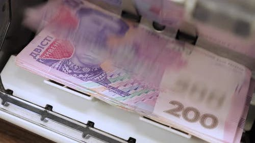 Ukrainian Banknotes in Currency Counting Machine Recounts Cash Hryvnias Money UA Banknotes