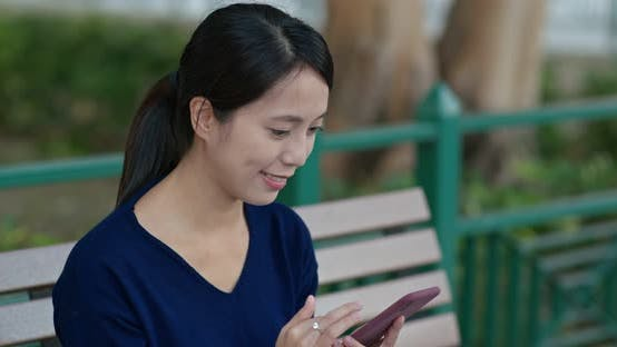 Thumbnail for Woman Use of Mobile Phone in The Park
