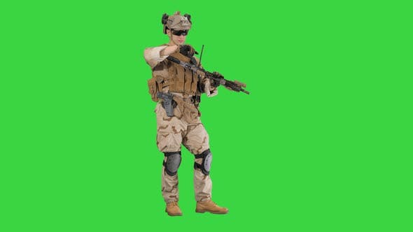 Thumbnail for Soldier in Camouflage Gear Checking His Uniform and Ammunition on a Green Screen, Chroma Key.