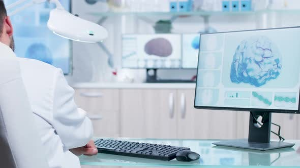 Thumbnail for Researcher in Medicine Field Typing in Computer Keyboard, Looking at X Ray Scan