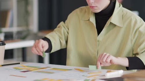 Creative Young Woman Brainstorming Ideas in Office