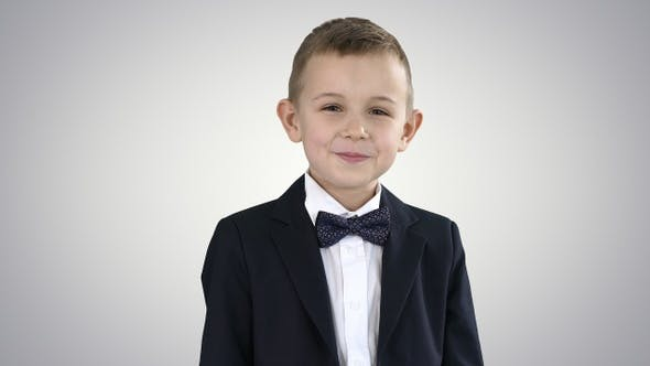 Thumbnail for Smiling Little Boy in Formal Clothes Standing on Gradient