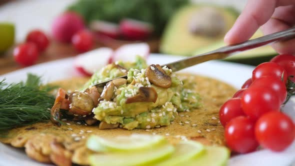 Thumbnail for Spreading Avocado Smash On Chickpea Pancake. Healthy Vegan Omelette.