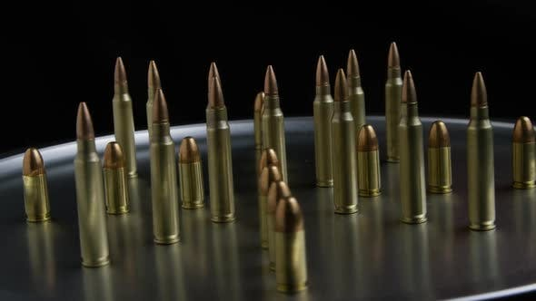 Thumbnail for Cinematic rotating shot of bullets on a metallic surface