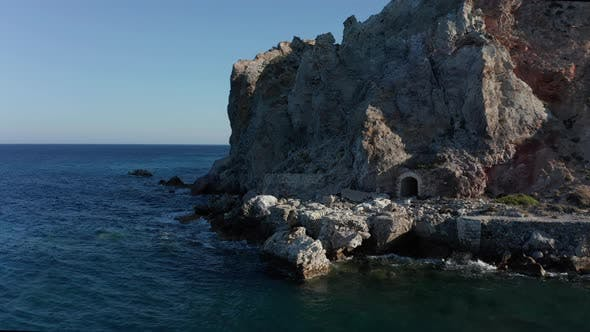 Old Abandoned Mine Entrance Tunnel in a Mountain at Beach on Milos Island, Greece Aerial View at
