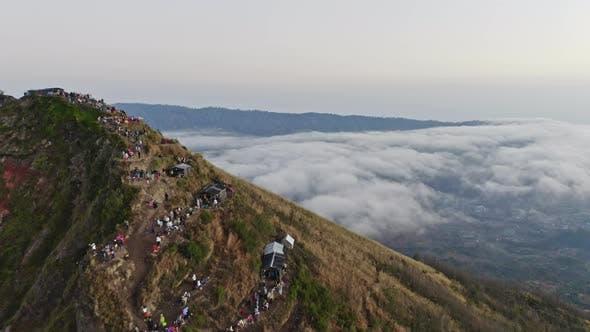 Thumbnail for Drone Over Tourists On Mountain Ridge Of Mount Batu