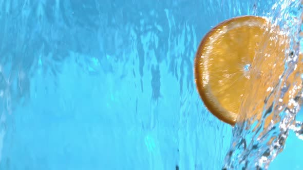 Thumbnail for Fresh Orange Slices Flying Into Water Cascade