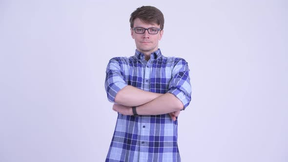 Thumbnail for Happy Young Handsome Hipster Man Smiling with Arms Crossed