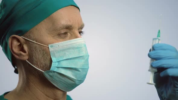 Thumbnail for Male Therapist in Face Mask Making Injection With Syringe, Medical Treatment