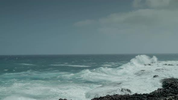 Thumbnail for Waves Crashing Against Rocks