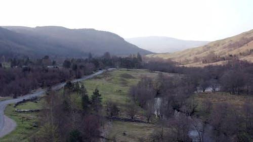 Road Winding Through Scottish Landscape