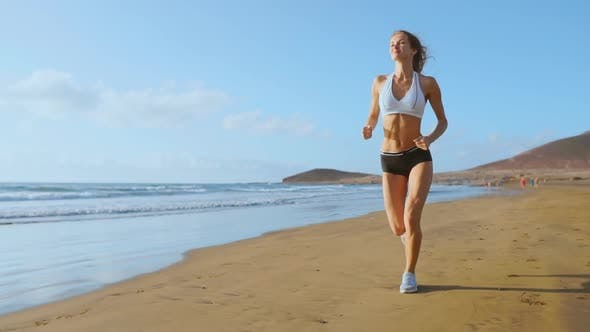 Thumbnail for Woman Athlete Silhouette Running on Beach Sprinting Waves Crashing on Seaside Morning Background