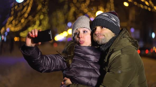 Thumbnail for Happy Couple Taking a Picture of Themselves