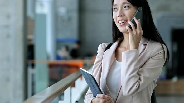 Thumbnail for Business woman holding tablet and talk to cellphone